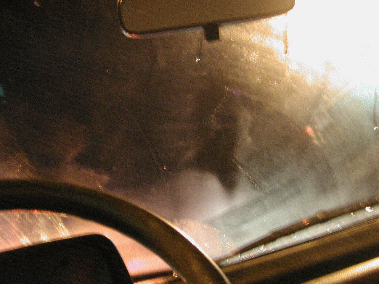 Car steering wheel in the rain