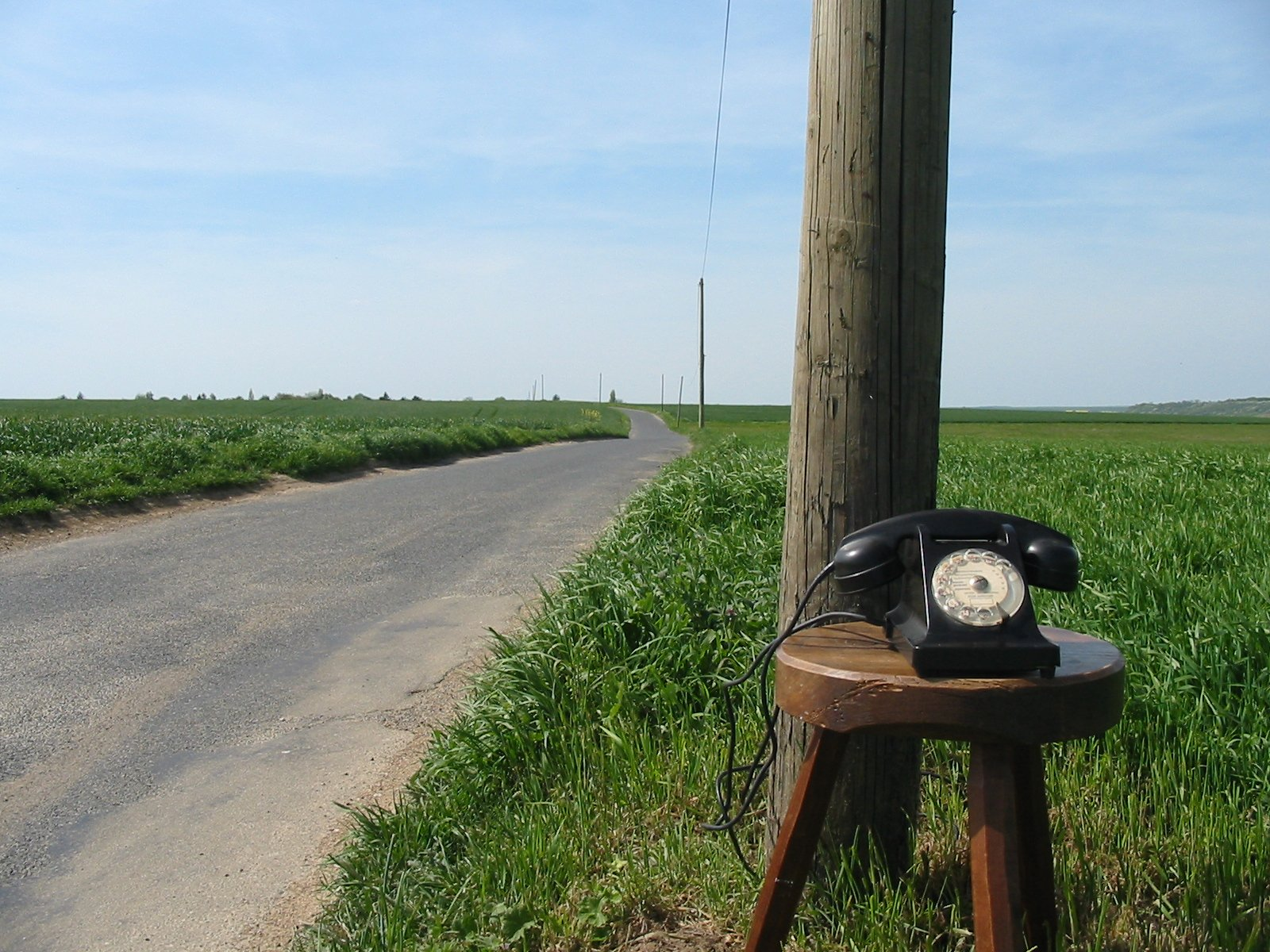 Old Fashion Phone Hooked Up to Telephone Pole in the Country