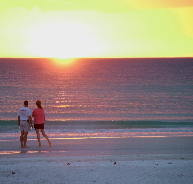 Free Couple Enjoy Sunset At The Beach Stock Photo
