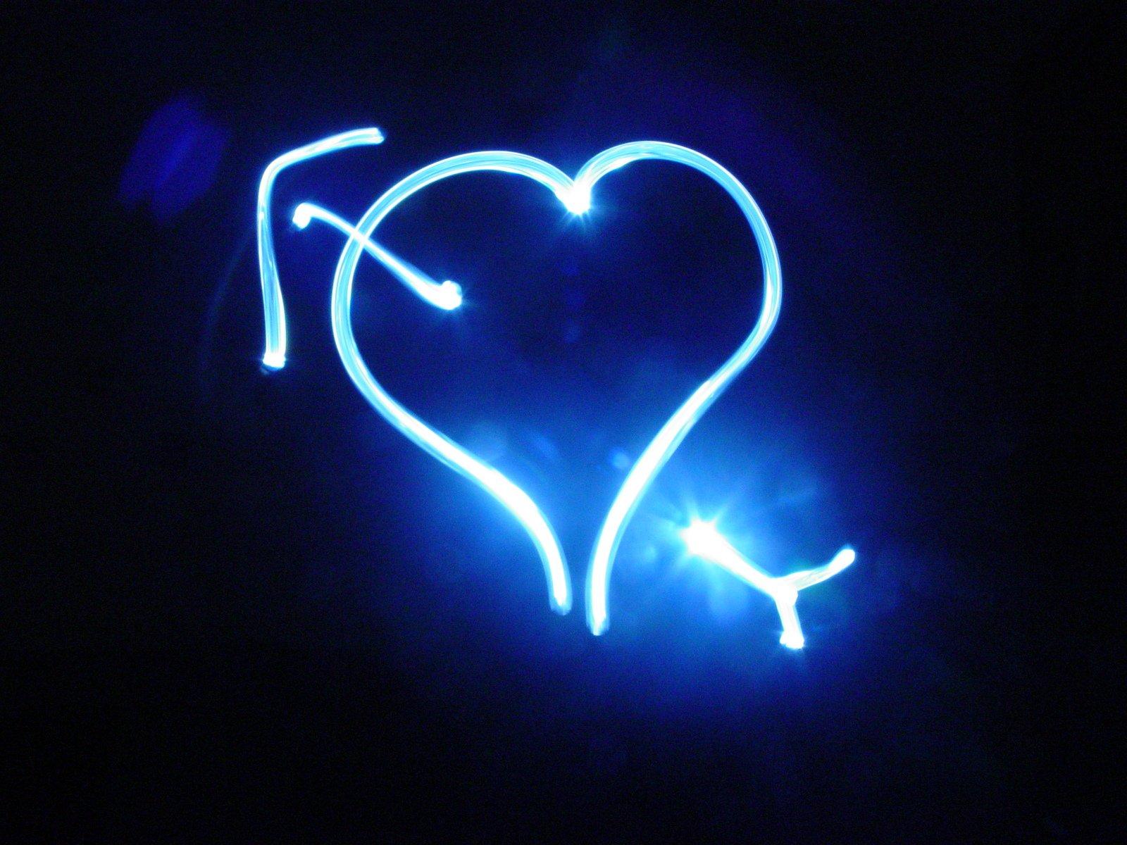 Neon arrow through the heart.