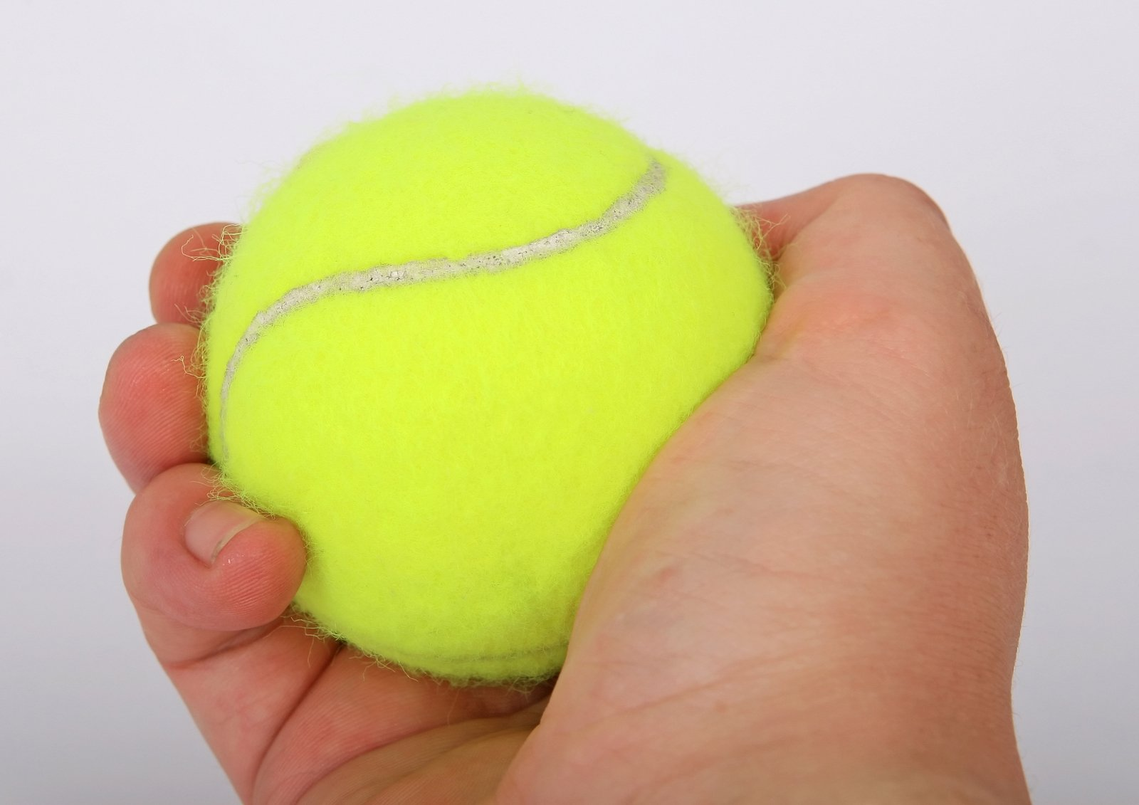 Tennis Ball and a hand