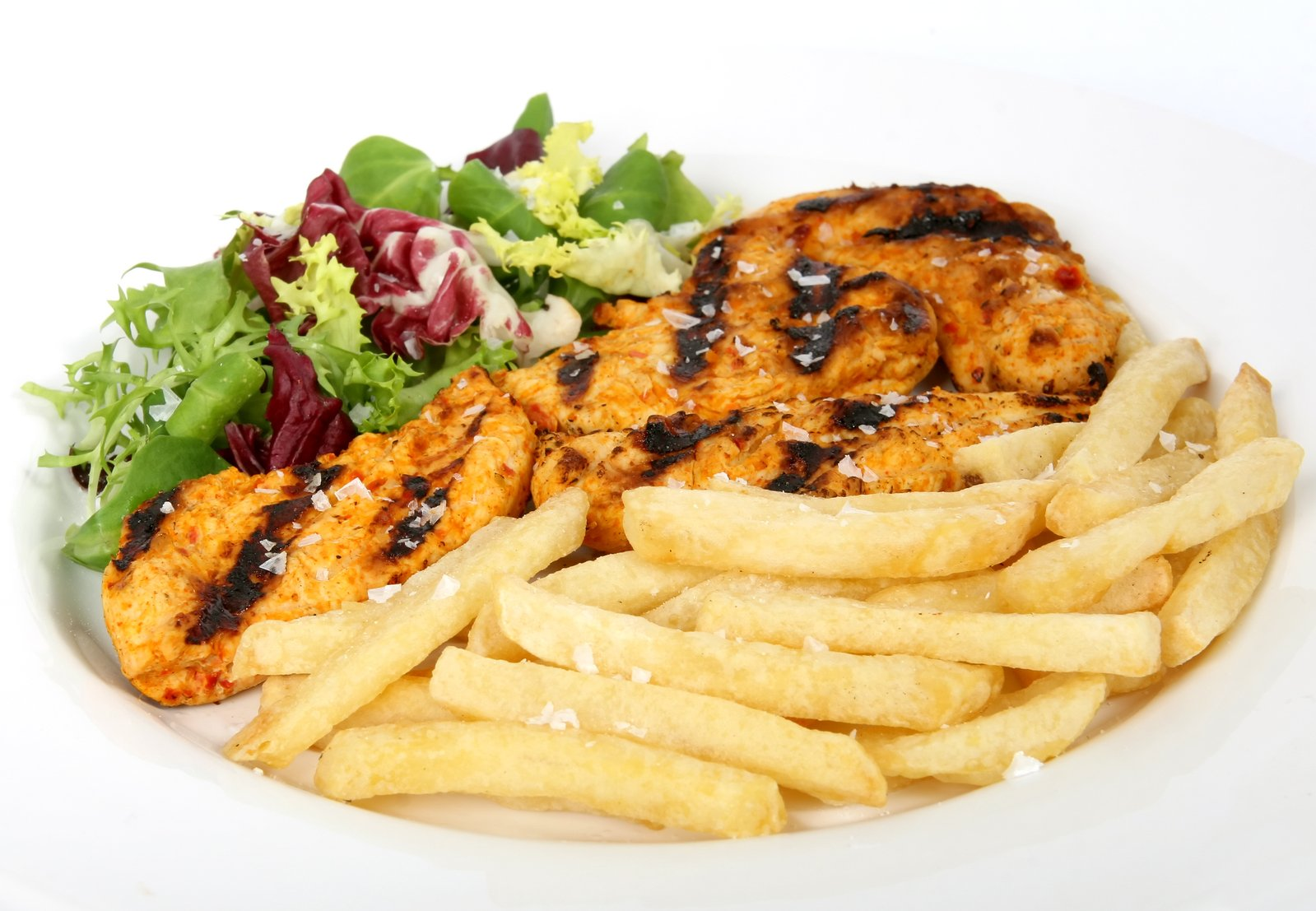 free summer barbeque chicken with salad and french fries stock photo