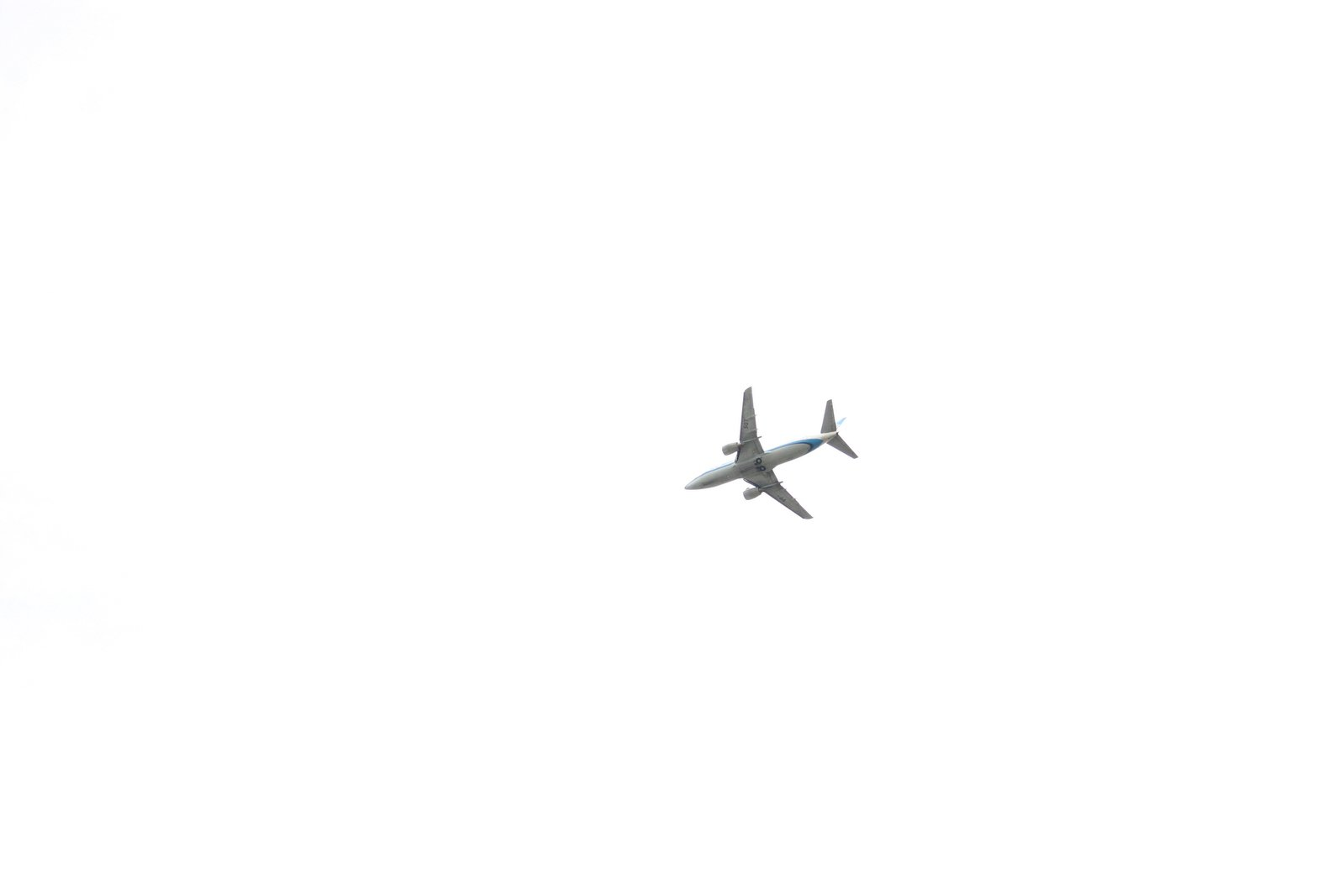 free airplane over an white sky stock photo freeimages com
