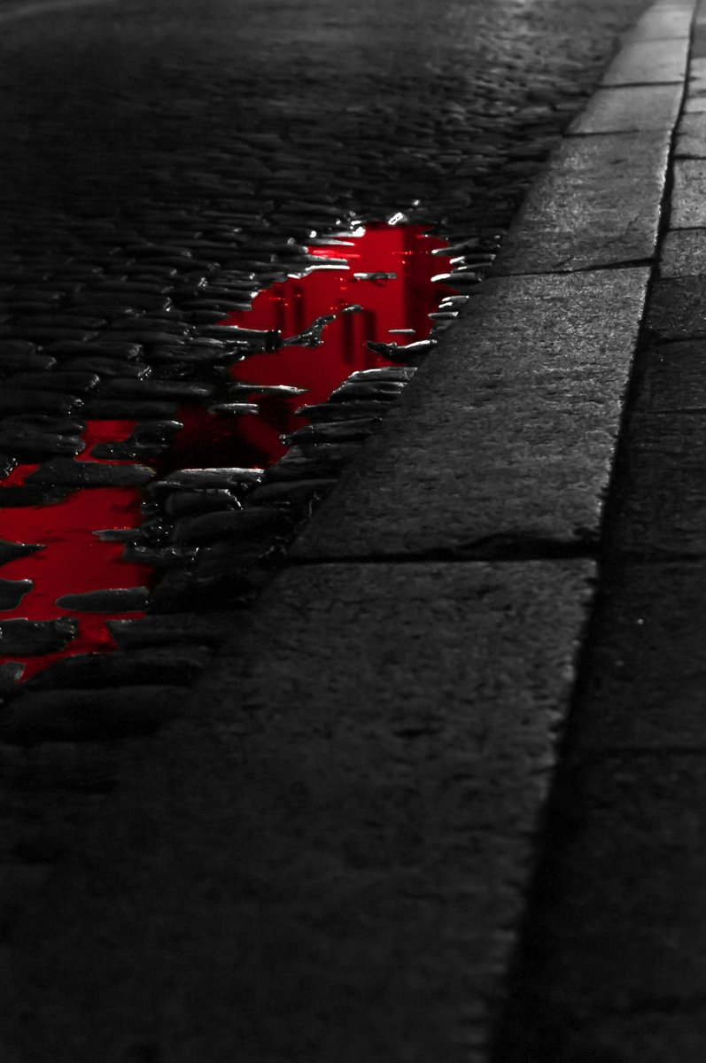 Bloody puddle in dark street
