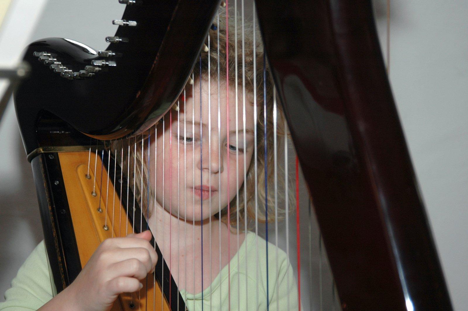 Little child playing Harp