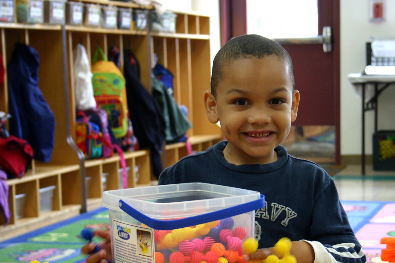 Child with toys in classroom