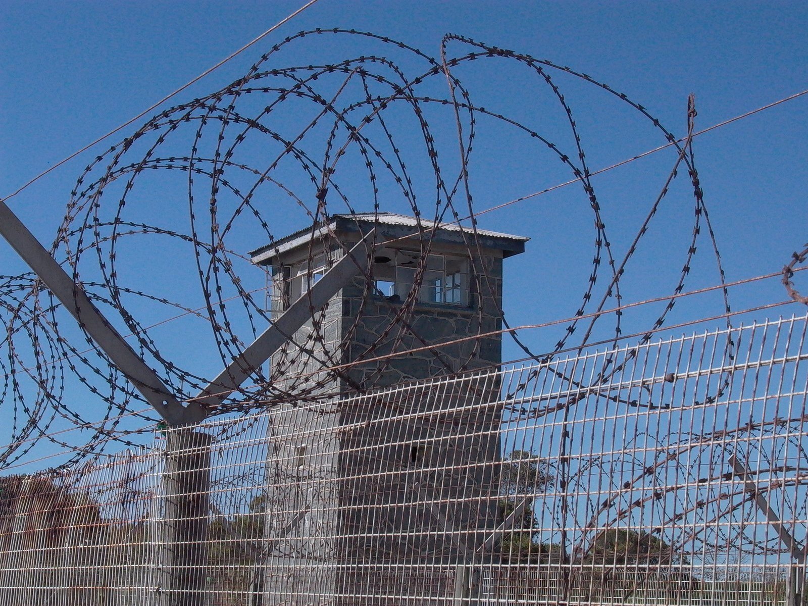 barbed wire around a prison