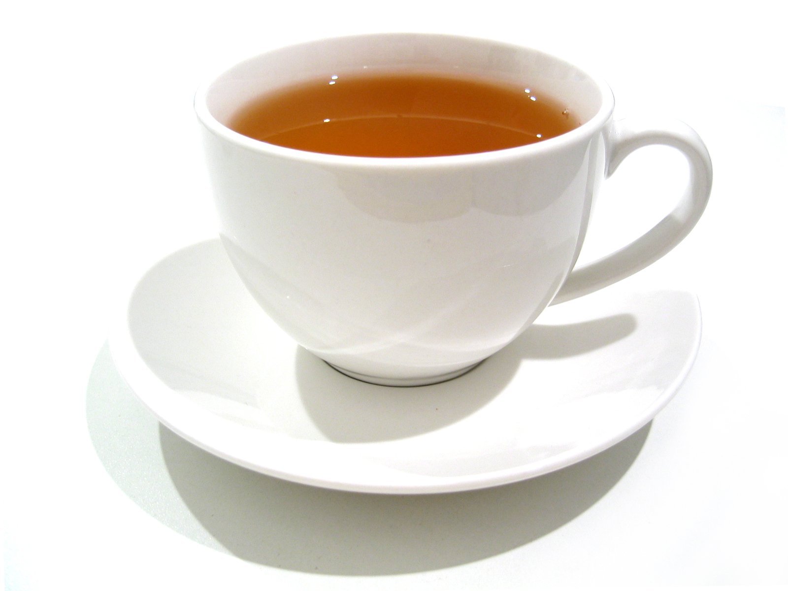a cup of tea in a white cup with saucer
