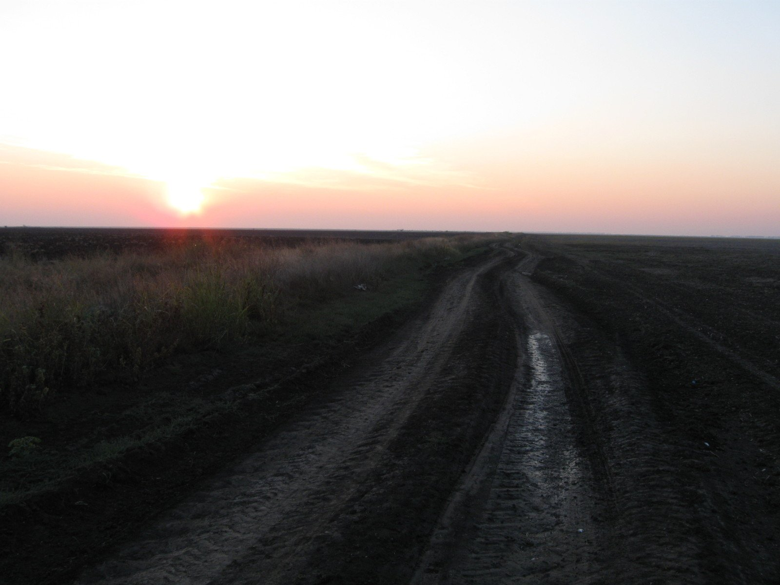 Free Sunset On A Dirt Road Stock Photo