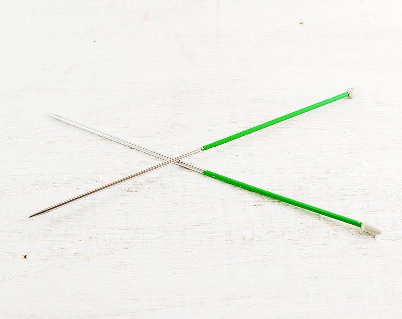free vintage metal knitting needles stock photo