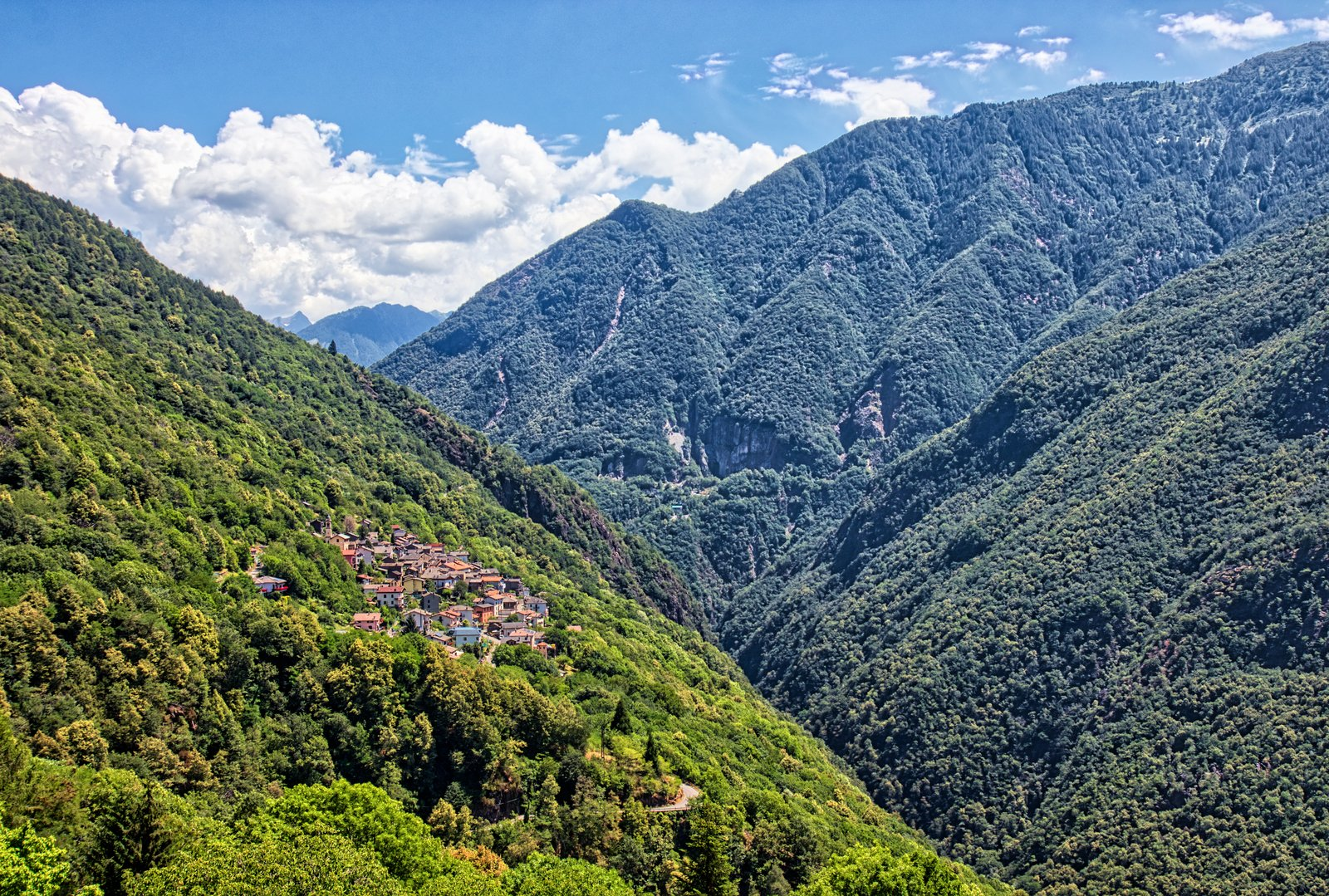 free a small town in the mountains above the lake como stock photo