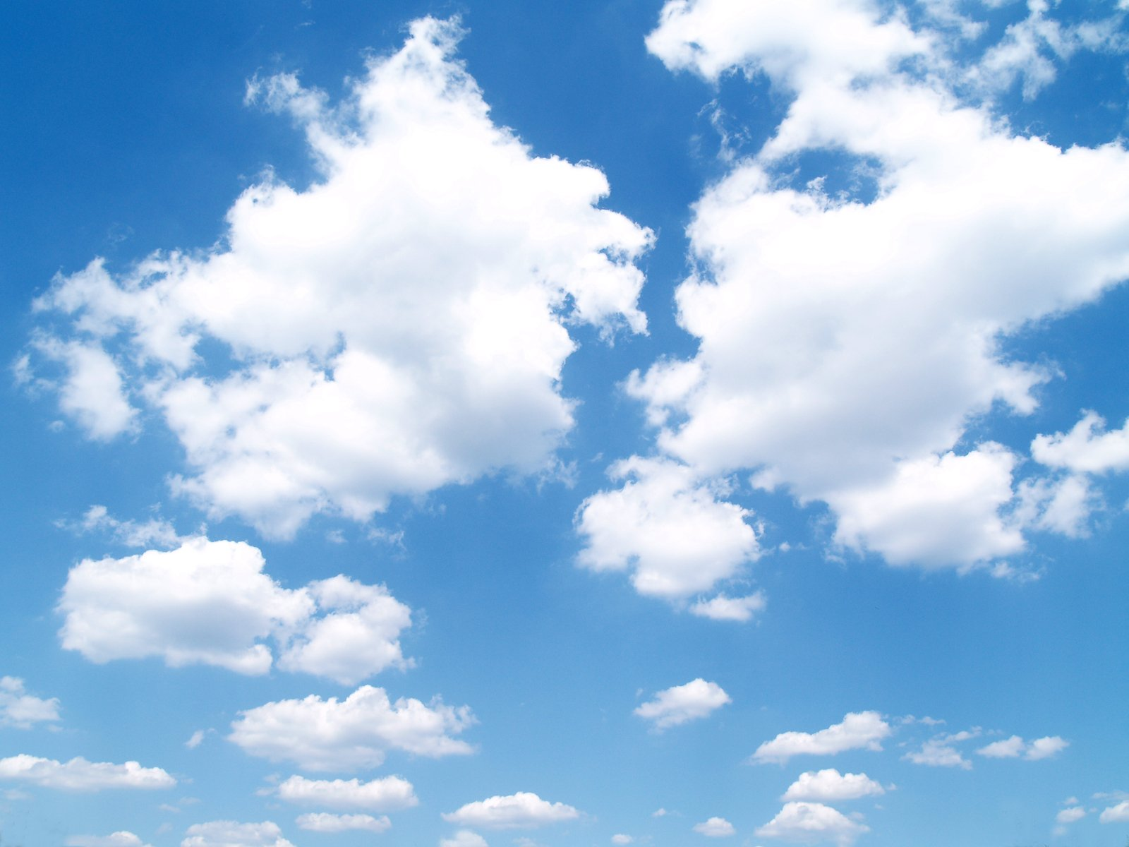 Free White clouds in blue sky Stock Photo - FreeImages.com