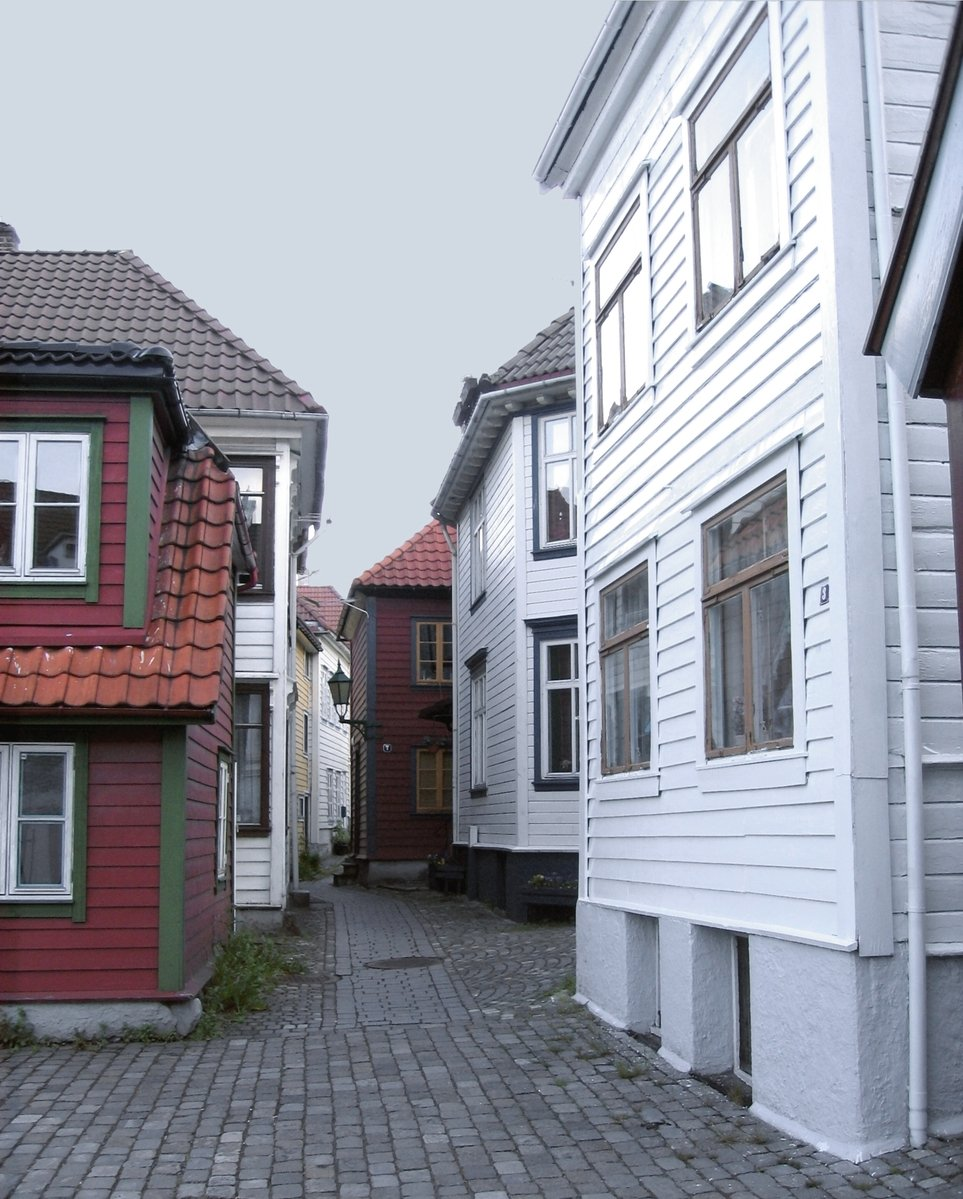 Free lane with norwegian wood houses stock photo for Norway wooden houses