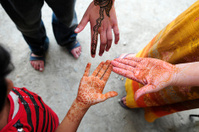 Three girls' hand with temporary decorative tattoo