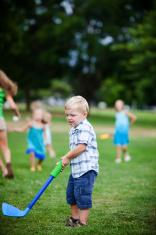 Little Boy Playing Golf