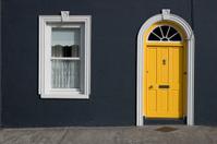 yellow door, white windows, black wall