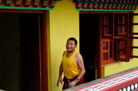 Monk wearing yellow singlet