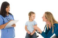 Pediatrician and Nurse Examine Young Girl