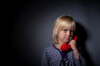 Sad child talking in phone