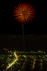 Fireworks burst over a city