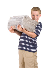 Standing Boy / Child Holding / Recycling A Stack Of  Newspapers.