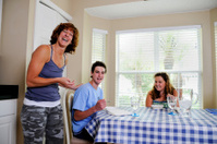 Three Person Funny Family Moment At Home in Kitchen