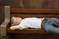 young drunk student sleep on bench