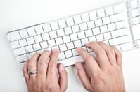 typing on white keyboard