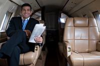Affluent Travel - Businessman inside private jet