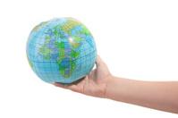 Hand holdlding globe