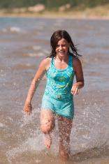 Teenager running in water