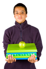 pakistan schoolboy is carying schoolbooks and an apple