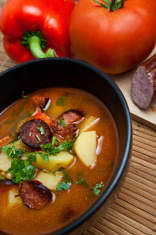 Delicious soup with paprika, tomatoes and potatoes
