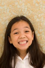 Asian Kid with Fake Smile