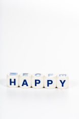 Blocks spell the word Happy