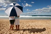 Beach umbrella couple horizontal