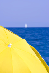 Yellow Umbrella and Blue Sea