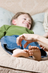 Child Getting Feet Tickled