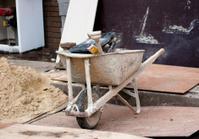Dirty Wheelbarrow with Tools