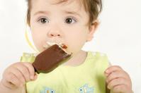 Baby girl eating an ice cream mini