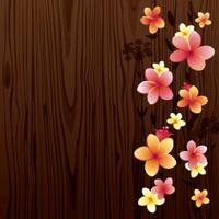 Frangipani (Plumeria) on wood