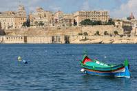 Luzzu fishing boat  in Grand Harbour, Malta