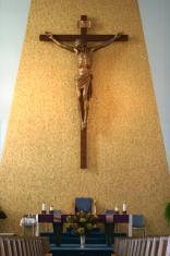 crucifix over alter