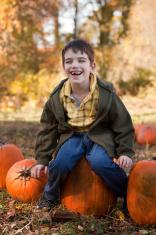 Happy kid in the pumpkin patch