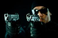 SWAT Officer holding two guns