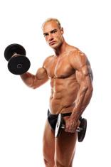 Six Pack Bodybuilder Lifting Dumbbells
