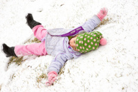 Little Girl Making Snow Angle (Vigorously)