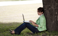 Happy female browsing outdoors