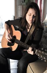 Girl Plucking Guitar