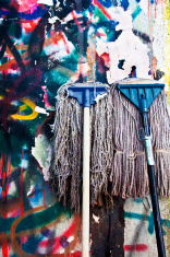 two mops and colorful background.